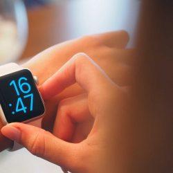 Teen reading a smart watch.