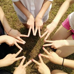 Teamwork: Hands In Star.