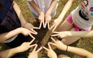 Teamwork: Hands In Star.